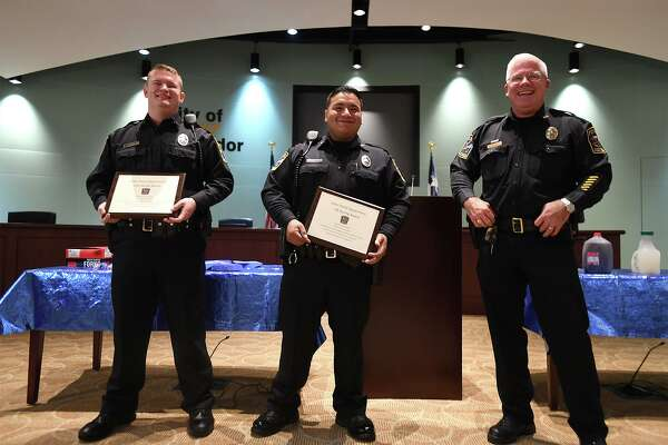 Vidor Police Chief Rod Carroll, right, gives Life Saving Awards to officers Manny Castillo, center, and Dillon LaPoint Wednesday from their response to an emergency call earlier this year. Photo taken Wednesday, 6/26/19