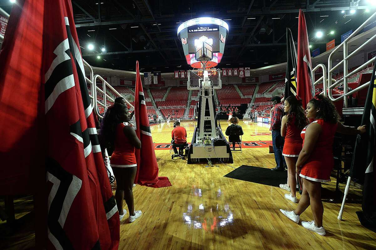 Lamar's cheerleaders await the entry on the court against New Orleans during their game Wednesday at the Montagne Center. Photo taken Wednesday, January 9, 2019 Photo by Kim Brent/The Enterprise