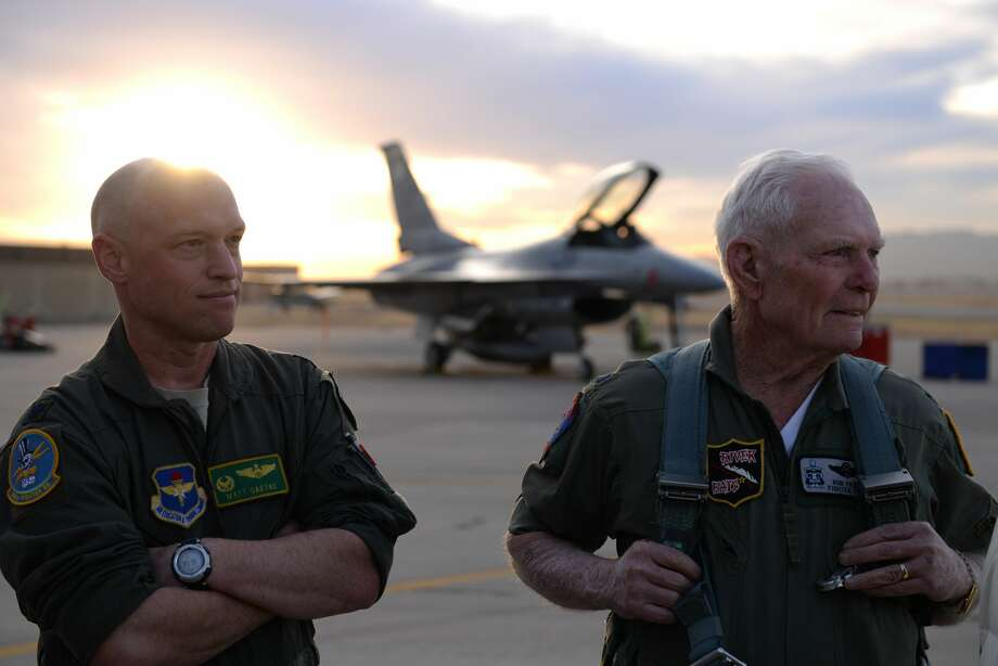 Lt. Col. Matthew Gaetke, 310th Fighter Squadron commander, and retired Air Force pilot Lt. Col. Bob Pardo, watch an F-16 Fighting Falcon take off at Luke Air Force Base in Arizona on Dec. 12, 2017. Pardo was there to speak to a graduating class of pilots. Photo: Senior Airman Ridge Shan/56th Fighter Wing Public Affairs