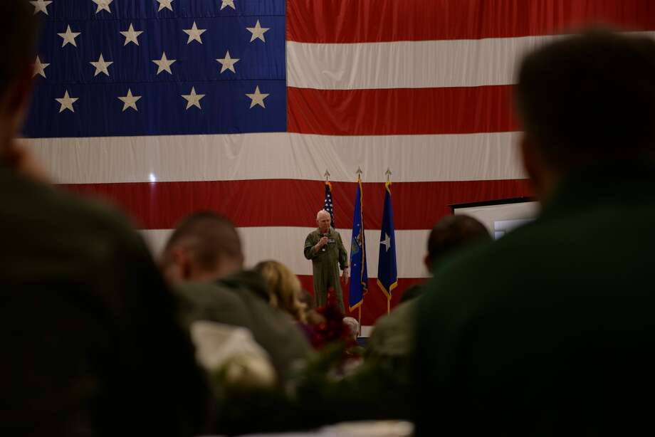 Retired Air Force pilot Lt. Col. Bob Pardo speaks to a group of graduating F-16 pilots and their friends and families at Luke Air Force Base in Arizona on Dec. 13, 2017. Photo: Senior Airman Ridge Shan/56th Fighter Wing Public Affairs