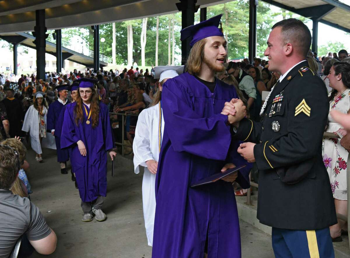 Graduate Jacob Dahoda shakes hands with SSG Brandon Moseman of the Army National Guard after receiving his diploma during the Ballston Spa High School graduation ceremony at Saratoga Performing Arts Center on Wednesday, June 26, 2019 in Saratoga Springs, N.Y. (Lori Van Buren/Times Union)