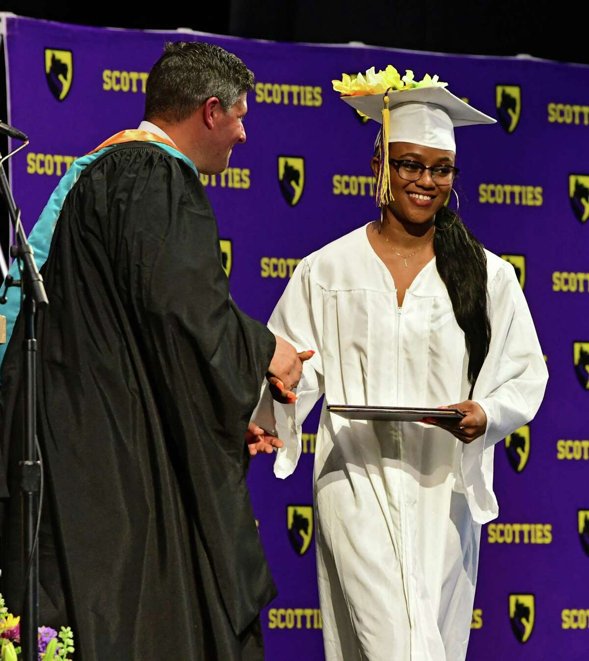 Tamara Myvette receives her diploma from Principal Gianleo Duca during the Ballston Spa High School graduation ceremony at Saratoga Performing Arts Center on Wednesday, June 26, 2019 in Saratoga Springs, N.Y. (Lori Van Buren/Times Union)