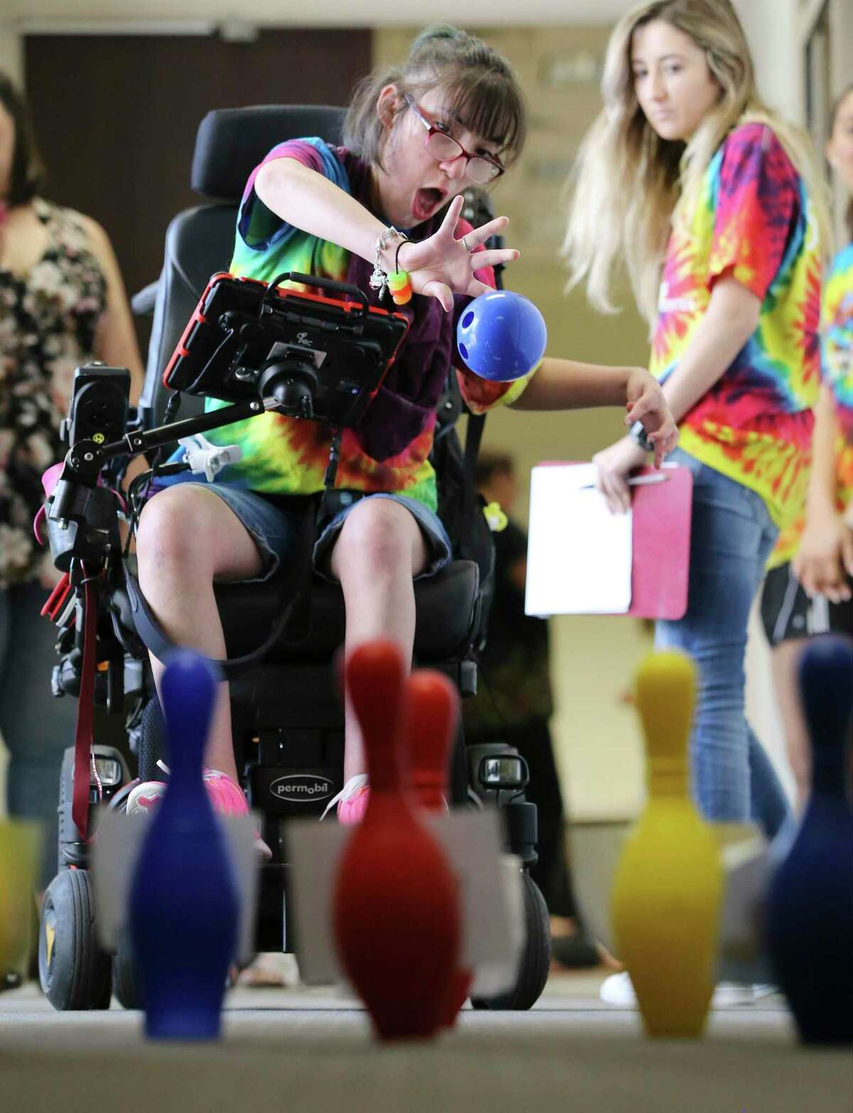 Kayla Janson, 19, plays a bowling-type game as children with communication disorders learn how to use alternative communication technology at Our Lady of the Lake University on Wednesday, June 26, 2019 during a weeklong summer program called Be AACtive Communicators. Janson has cerebral palsy. OLLU speech pathology students took part in the program as part of their course work and helped 12 kids aged 5 to 17 use tablet-like technology to supplement their communication skills. The free program has been around for three years. (Kin Man Hui/San Antonio Express-News)