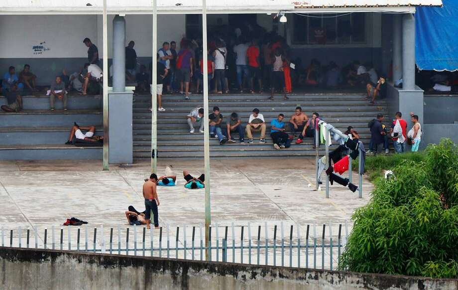In this June 1, 2019 photo, migrants mill around a courtyard of Siglo XXI migrantdetention center in Tapachula, Chiapas state, Mexico. An average stay for a migrantat the overcrowded detention center will not last more than two weeks. Photo: Associated Press/Marco Ugarte