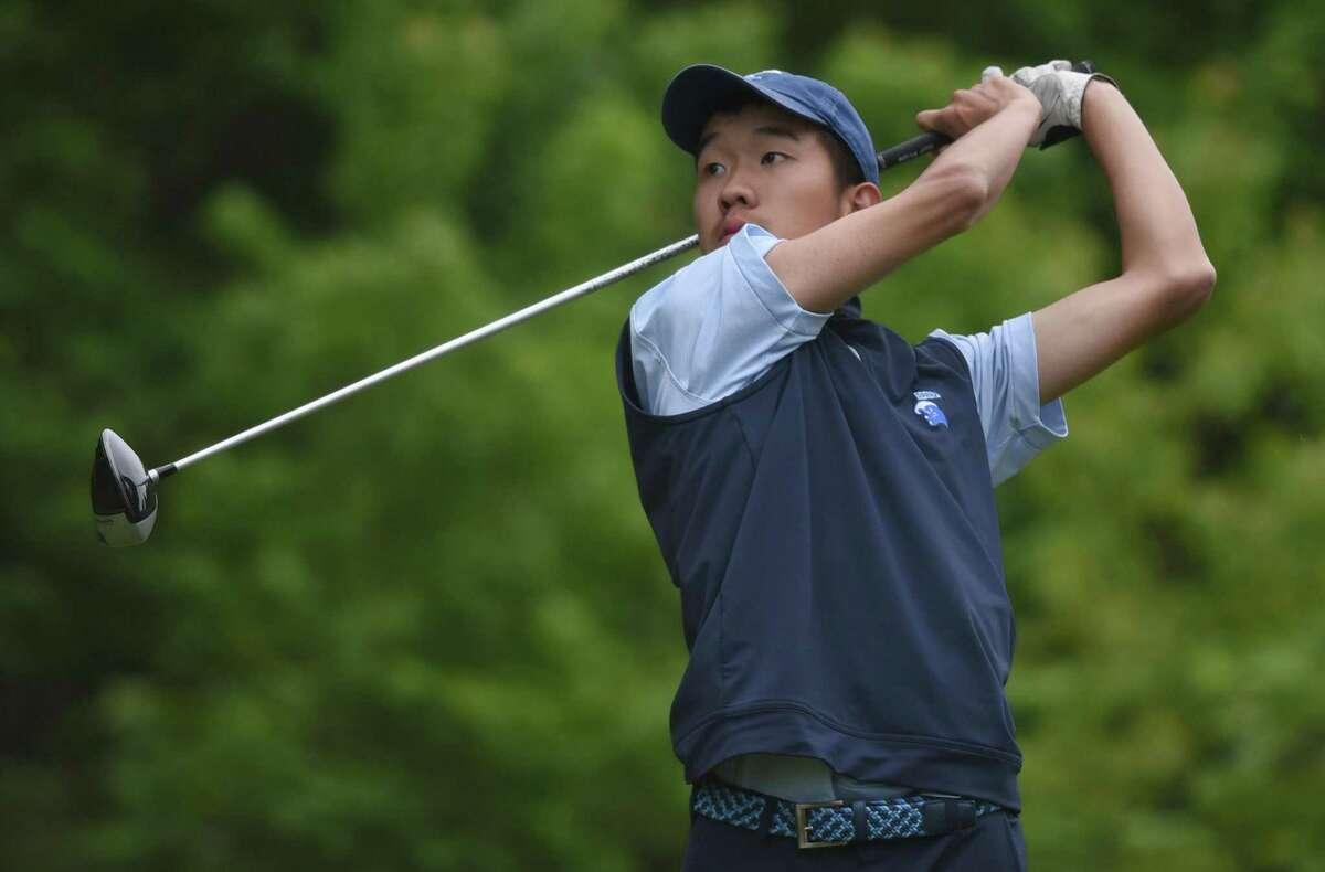 Darien's Alex Gu follows the flight of the ball during the FCIAC boys golf championships at Fairchild Wheeler Golf Course in Fairfield on May 30.