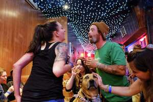 Darla the mutt gets some attention at Dottie's Double Wide, which opened in 2018 and hosted a drag event and stayed busy over White Center Pride weekend.