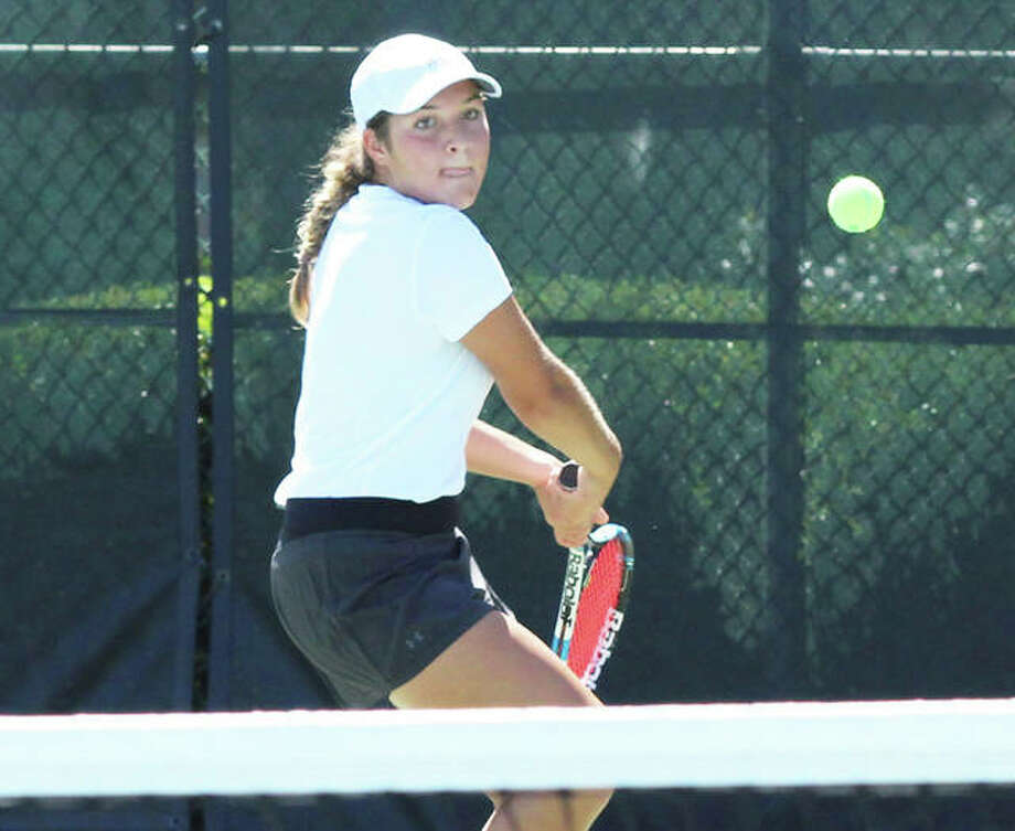 Hannah Macias makes a return during last year's Alton Open Tennis Tournament. The area summer tennis season has long featured many opportunities for various levels of play. Photo: Telegraph File Photo