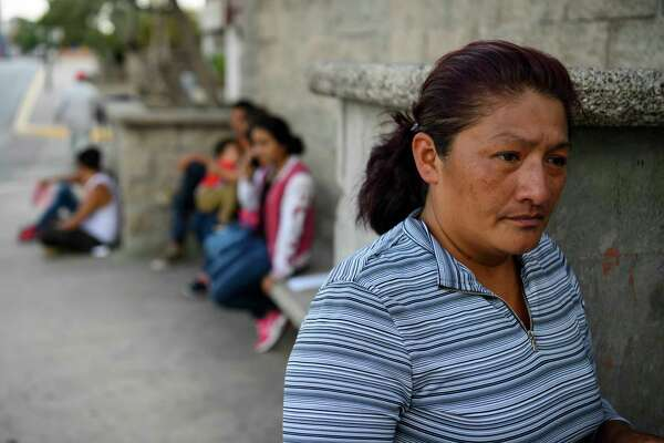 Damarys Perez Carrillo, from Guatemala, waits near the U.S.-Mexico border shortly after being returned to Ciudad Juarez, Mexico, to wait for her hearing in the United States on June 13, 2019.