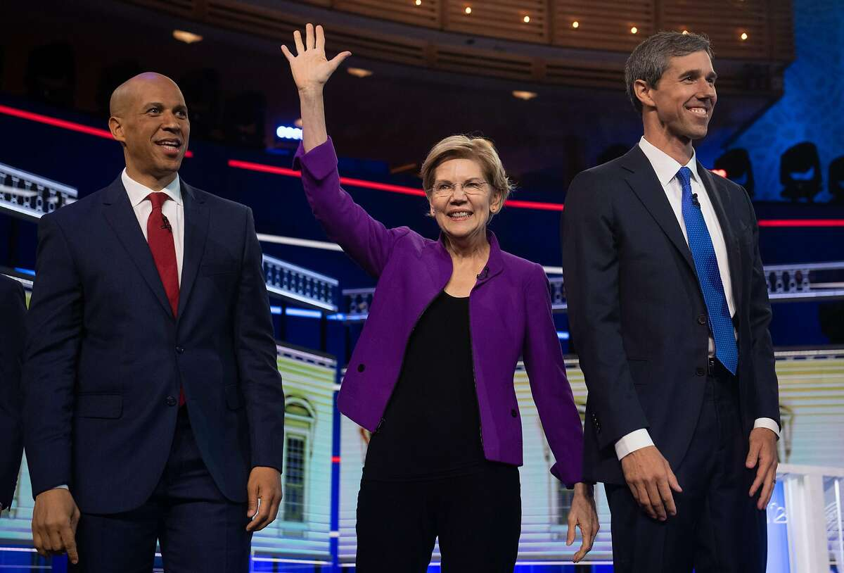 Democratic presidential hopefuls (fromL) US Senator from New Jersey Cory Booker, US Senator from Massachusetts Elizabeth Warren and former US Representative for Texas' 16th congressional district Beto O'Rourke arrive to participate in the first Democratic primary debate of the 2020 presidential campaign season hosted by NBC News at the Adrienne Arsht Center for the Performing Arts in Miami, Florida, June 26, 2019. (Photo by SAUL LOEB / AFP)SAUL LOEB/AFP/Getty Images