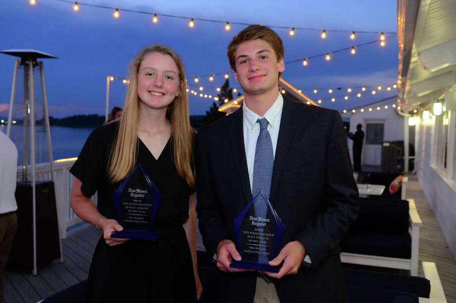 New Haven Register Athletes of the Year Mia Juodaitis, of Cheshire High, and John DeLucia, of Guilford High, pose together after the New Haven Register's Annual MVP Banquet at Amarante's Sea Cliff in New Haven on Wednesday. Photo: Christian Abraham / Hearst Connecticut Media / Connecticut Post