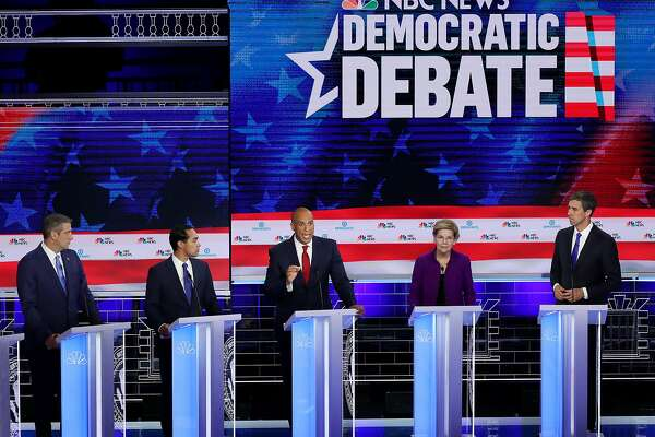 MIAMI, FLORIDA - JUNE 26: Sen. Cory Booker (C) (D-NJ), Rep. Tim Ryan (L) (D-OH) former housing secretary Julian Castro (2ndL) Sen. Elizabeth Warren(2ndR) (D-MA) and former Texas congressman Beto O'Rourke (R) look on during the first night of the Democratic presidential debate on June 26, 2019 in Miami, Florida. A field of 20 Democratic presidential candidates was split into two groups of 10 for the first debate of the 2020 election, taking place over two nights at Knight Concert Hall of the Adrienne Arsht Center for the Performing Arts of Miami-Dade County, hosted by NBC News, MSNBC, and Telemundo. (Photo by Joe Raedle/Getty Images)