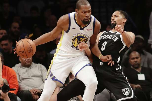 Brooklyn Nets' Spencer Dinwiddie (8) defends against Golden State Warriors' Kevin Durant (35) during the second half of an NBA basketball game Sunday, Oct. 28, 2018, in New York. (AP Photo/Frank Franklin II)