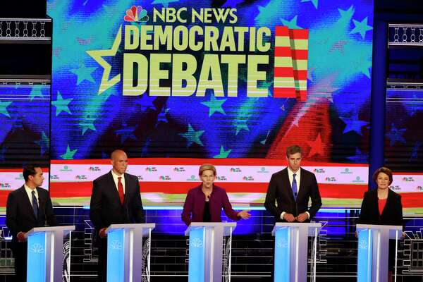 Democratic presidential candidate Sen. Elizabeth Warren, D-Mass., center, answers a question, during the Democratic primary debate hosted by NBC News at the Adrienne Arsht Center for the Performing Art, Wednesday, June 26, 2019, in Miami. Listening from left are, former Housing and Urban Development Secretary Julian Castro, Sen. Cory Booker, D-N.J., former Texas Rep. Beto O'Rourke, and Sen. Amy Klobuchar, D-Minn.