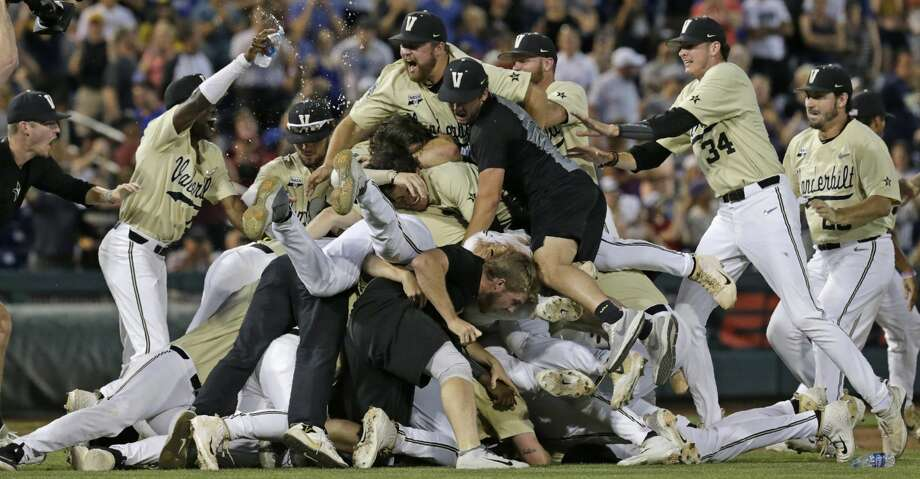 Vanderbilt players celebrate after defeating Michigan to win Game 3 of the NCAA College World Series baseball finals in Omaha, Neb., Wednesday, June 26, 2019. (AP Photo/Nati Harnik) Photo: Nati Harnik/Associated Press