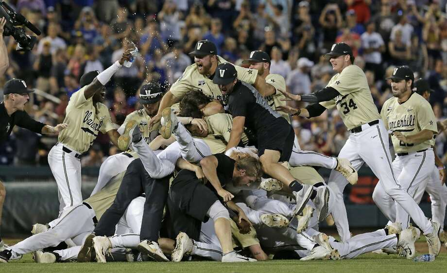 Vanderbilt players pile on after defeating Michigan in Omaha, Neb. on Wednesday night. Photo: Nati Harnik / Associated Press