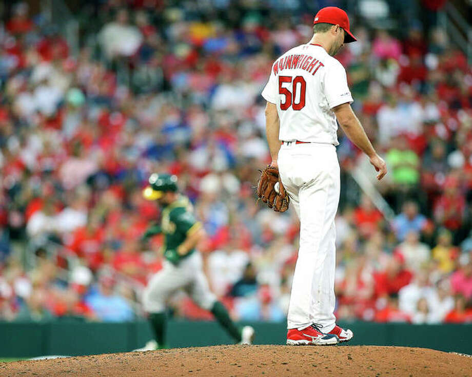 Cardinals pitcher Adam Wainwright pauses on the mound as Oakland's Beau Taylor circles the bases after hitting a solo home run in the fourth inning of Wednesday night's game in St. Louis. Photo: Scott Kane | AP Photo