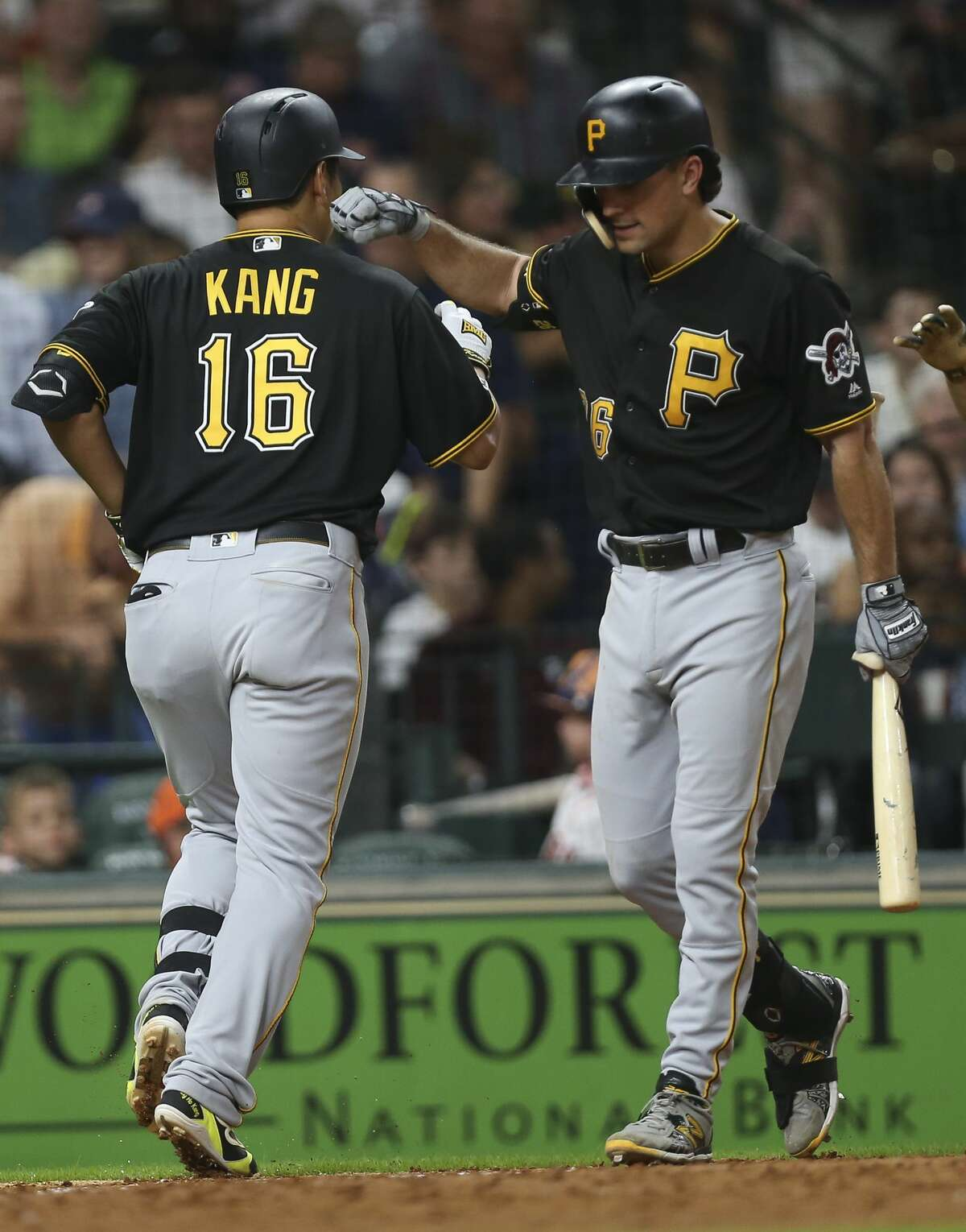 Pittsburgh Pirates third baseman Jung Ho Kang (16) is congratulated by Adam Frazier (26) after his two-run home run during the top sixth inning of the MLB game against the Houston Astros at Minute Maid Park on Wednesday, June 26, 2019, in Houston.