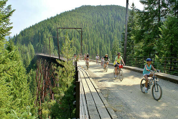 The Route of the Hiawatha mountain bike or hike trail is 15 miles long with 10 train tunnels and 7 sky-high trestles.