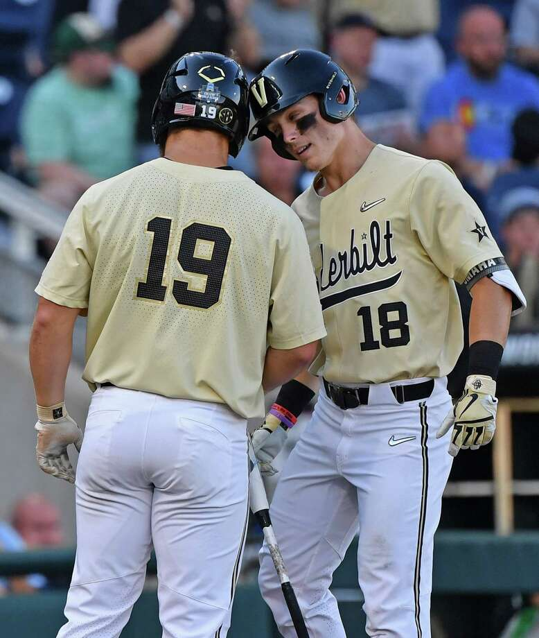 OMAHA, NE - JUNE 26:  Pat DeMarco #18 of the Vanderbilt Commodores celebrates with teammate Stephen Scott #19 after hitting a solo home run in the second inning against the Michigan Wolverines during game three of the College World Series Championship Series on June 26, 2019 at TD Ameritrade Park Omaha in Omaha, Nebraska.  (Photo by Peter Aiken/Getty Images) Photo: Peter Aiken / 2019 Getty Images