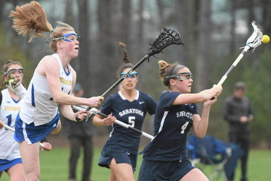 Queensbury midfielder Maddie Montgomery leaps through the air but fails to scoop the ball before Saratoga midfielder Lindsey Frank following face-off during a game at Queensbury Central School in Queensbury, N.Y., on Thursday, May 2, 2019. (Jenn March, Special to the Times Union ) Photo: Jenn March / © Jenn March 2018 © Albany Times Union 2018