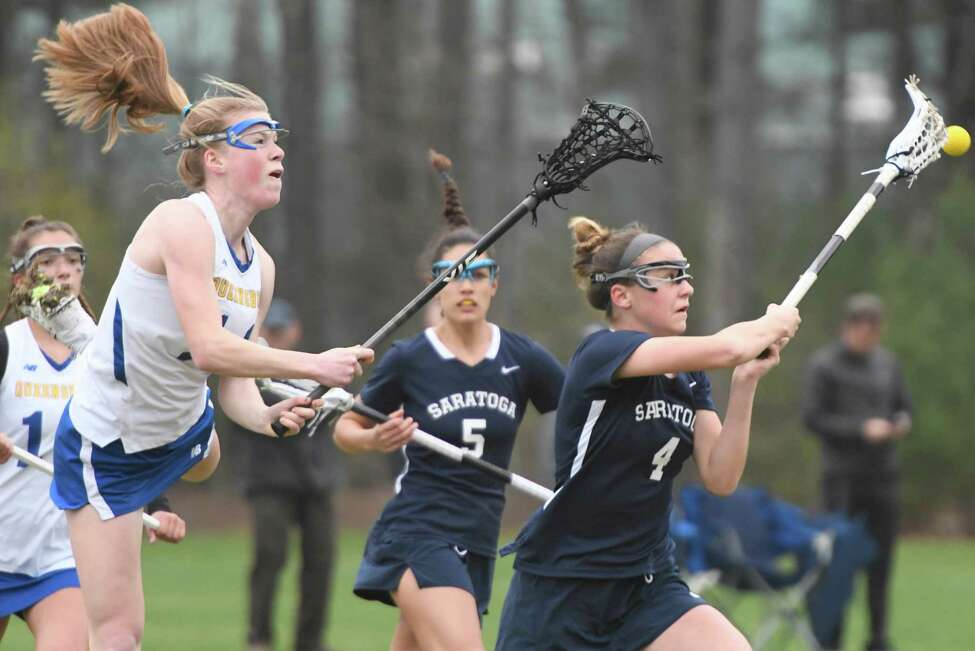 Queensbury midfielder Maddie Montgomery leaps through the air but fails to scoop the ball before Saratoga midfielder Lindsey Frank following face-off during a game at Queensbury Central School in Queensbury, N.Y., on Thursday, May 2, 2019. (Jenn March, Special to the Times Union )