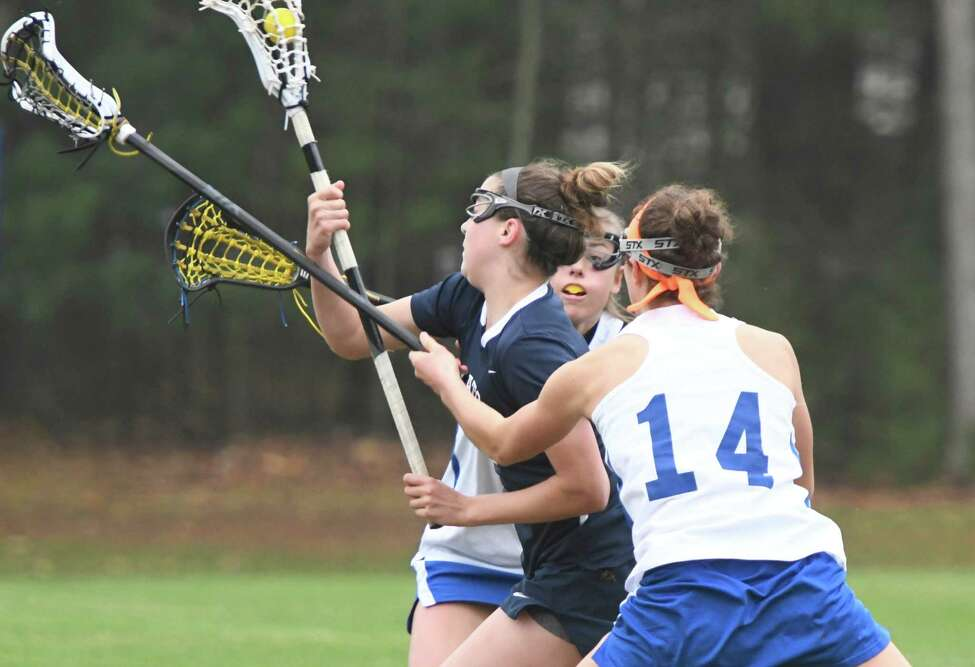 Saratoga midfielder Lindsey Frank is sandwiched between two Queensbury players as she breaks for the Queensbury goal during a game at Queensbury Central School in Queensbury, N.Y., on Thursday, May 2, 2019. (Jenn March, Special to the Times Union )