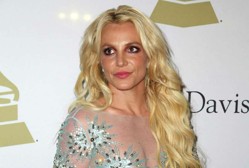 FILE - This Feb. 11, 2017 file photo shows Britney Spears at the Clive Davis and The Recording Academy Pre-Grammy Gala in Beverly Hills, Calif. The conservatorship that runs Britney Spears? affairs has sued a man who runs a Spears-themed blog for defamation. The lawsuit filed Wednesday, June 26, 2019, in Los Angeles Superior Court alleges that Anthony Elia, who writes the blog Absolute Britney, has spread falsehoods about the conservatorship. The suit says the blog falsely claimed that the conservatorship, which is run by Spears? father Jamie, was manipulating her Instagram account to make her appear more troubled and in need of help than she actually is. (Photo by Rich Fury/Invision/AP, File)
