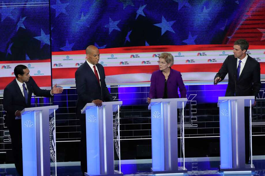 MIAMI, FLORIDA - JUNE 26: Former housing secretary Julian Castro, Sen. Cory Booker (D-NJ) Sen. Elizabeth Warren (D-MA) and former Texas congressman Beto O'Rourke take part in the first night of the Democratic presidential debate on June 26, 2019 in Miami, Florida.  A field of 20 Democratic presidential candidates was split into two groups of 10 for the first debate of the 2020 election, taking place over two nights at Knight Concert Hall of the Adrienne Arsht Center for the Performing Arts of Miami-Dade County, hosted by NBC News, MSNBC, and Telemundo. (Photo by Joe Raedle/Getty Images) Photo: Joe Raedle, Staff / Getty Images / 2019 Getty Images