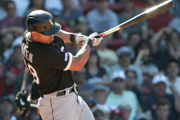 Chicago White Sox's Jose Abreu hits a two-run homer in the ninth inning of a baseball game against the Boston Red Sox at Fenway Park, Wednesday, June 26, 2019, in Boston. (AP Photo/Elise Amendola)