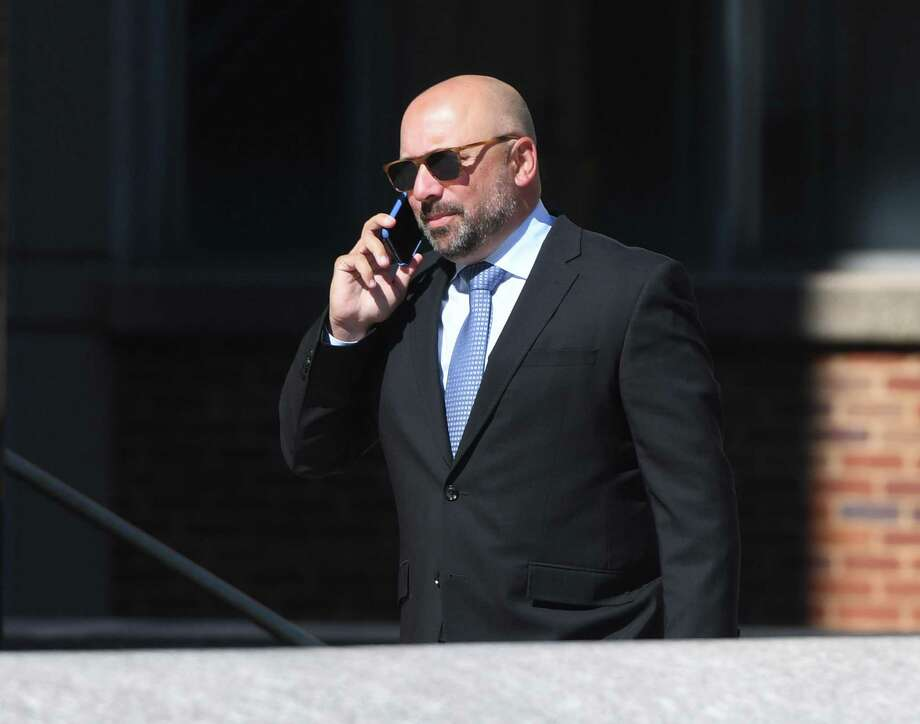 Michael Meehan, a Bridgeport attorney and a court-appointed guardian at litem for the five Dulos children, enters the Connecticut Superior Court in Stamford, Conn. Wednesday, June 26, 2019. Fotis Dulos appeared with his attorneys, Norm Pattis and Rich Rochlin, for a hearing Wednesday on motion by a divorce attorney for Jennifer Dulos to have Fotis Dulos and his attorneys held in contempt and for the court to impose sanctions for violating a judge's order that sealed a custody and psychological evaluation conducted on the Dulos family. Photo: Tyler Sizemore / Hearst Connecticut Media / Greenwich Time