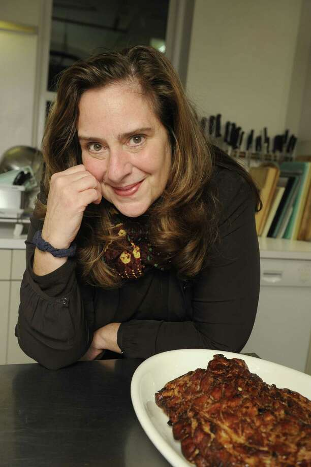 """Molly O'Neill, with a ribs dish from her new cookbook """"One Big Table"""", at a dinner party at a Chelsea apartment.   (Photo by Helayne Seidman/For The Washington Post via Getty Images) Photo: The Washington Post / 2011 The Washington Post"""
