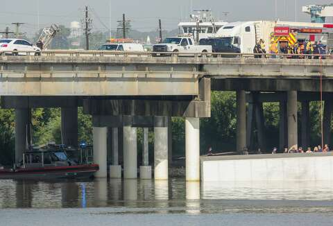 Driver believed dead after semi-truck plunges off bridge into San