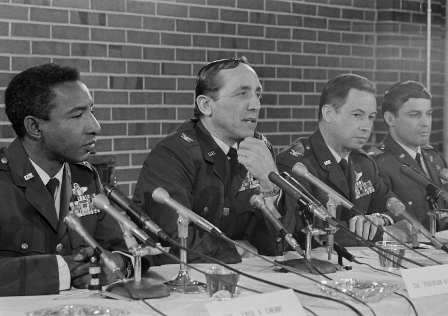 "Then-Col. Robinson Risner, second from left, at a 1973 news conference at Andrews Air Force Base near Washington, D.C. During the Korean War in 1952, Risner, a fighter-pilot, pushed a crippled U.S. plane 60 miles, a maneuver that foreshadowed ""Pardo's Push."" Photo: Henry Griffin/AP"