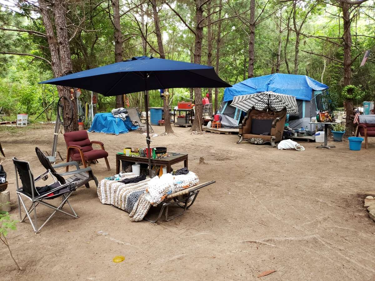 Deputies found multiple people living in tents with makeshift beds, chairs and other furniture Wednesday at the site located in the 16900 block of Nanes Drie and FM 1960.
