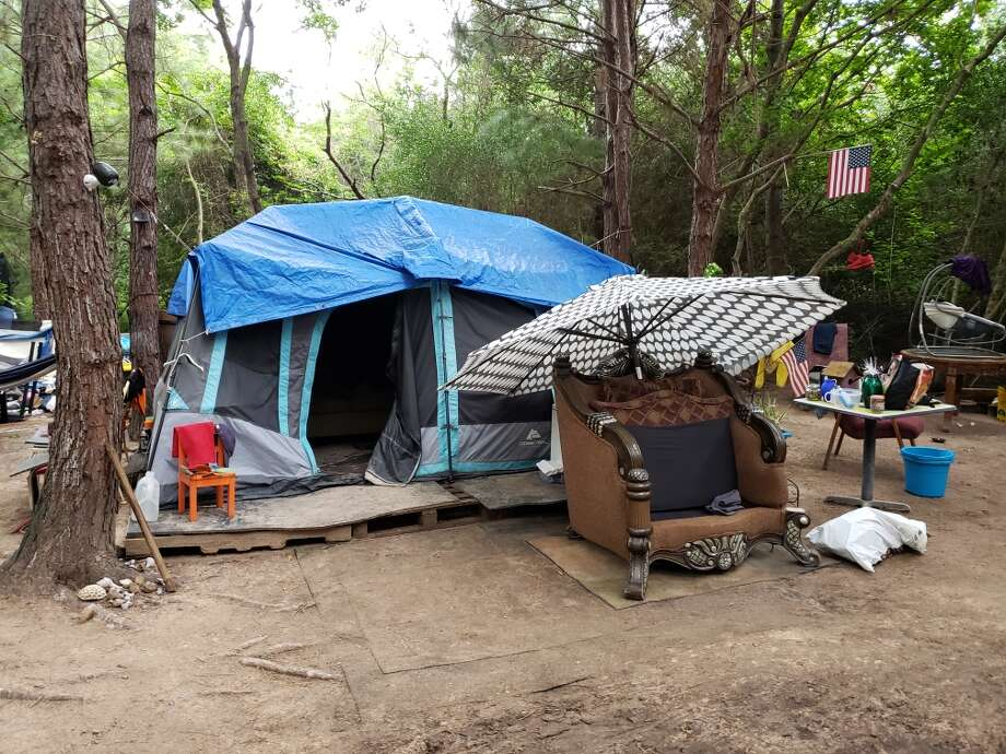Deputies found multiple people living in tents with makeshift beds, chairs and other furniture Wednesday at the site located in the 16900 block of Nanes Drie and FM 1960. Photo: Harris County Constable Precinct 4