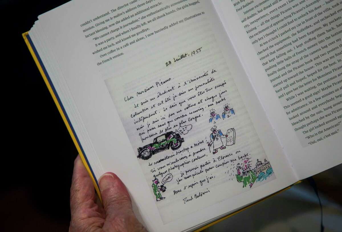 Fred Baldwin holds open a page in his new memoir that shows a hand-illustrated note he wrote to Pablo Picasso in 1955, at his home near the Menil Collection in Houston, Tuesday, June 25, 2019. Baldwin has written a memoir called