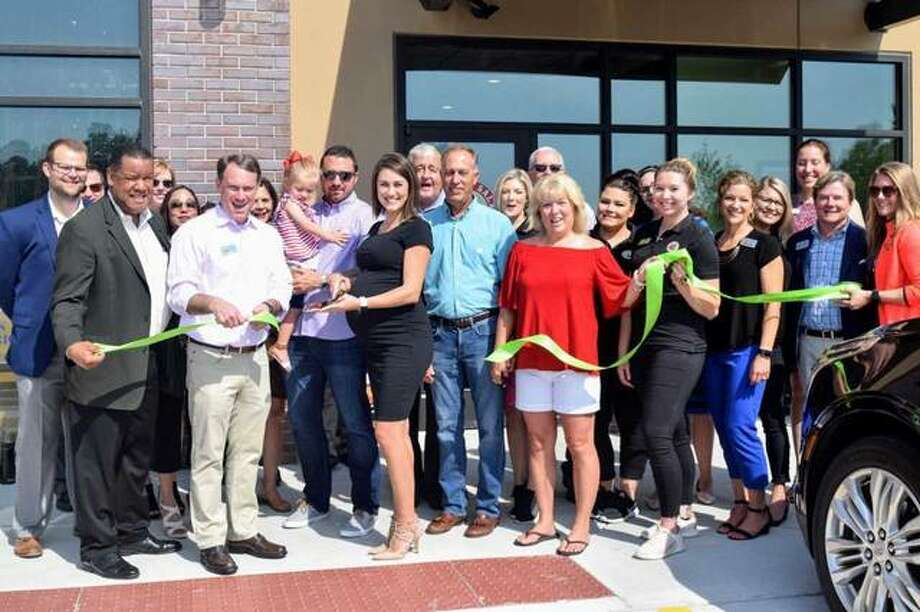 Chicken Salad Chick celebrated its grand opening Wednesday in Edwardsville at the new Ironworks development. Owner Hannah Lukowski (center) is surrounded by family, staff and members of the Edwardsville/Glen Carbon Chamber of Commerce. Giveaways for patrons will continue on Friday and Saturday. Photo: Courtesy Of Edwardsville/Glen Carbon Chamber Of Commerce