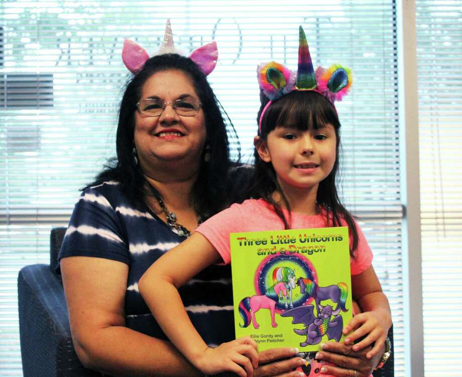 """Lake Houston resident Ellie Gordy and her 7-year-old granddaughter AhlynnFletcherpublished a book together called """"Three Little Unicorns and a Dragon"""" Photo: Kaila Contreras"""