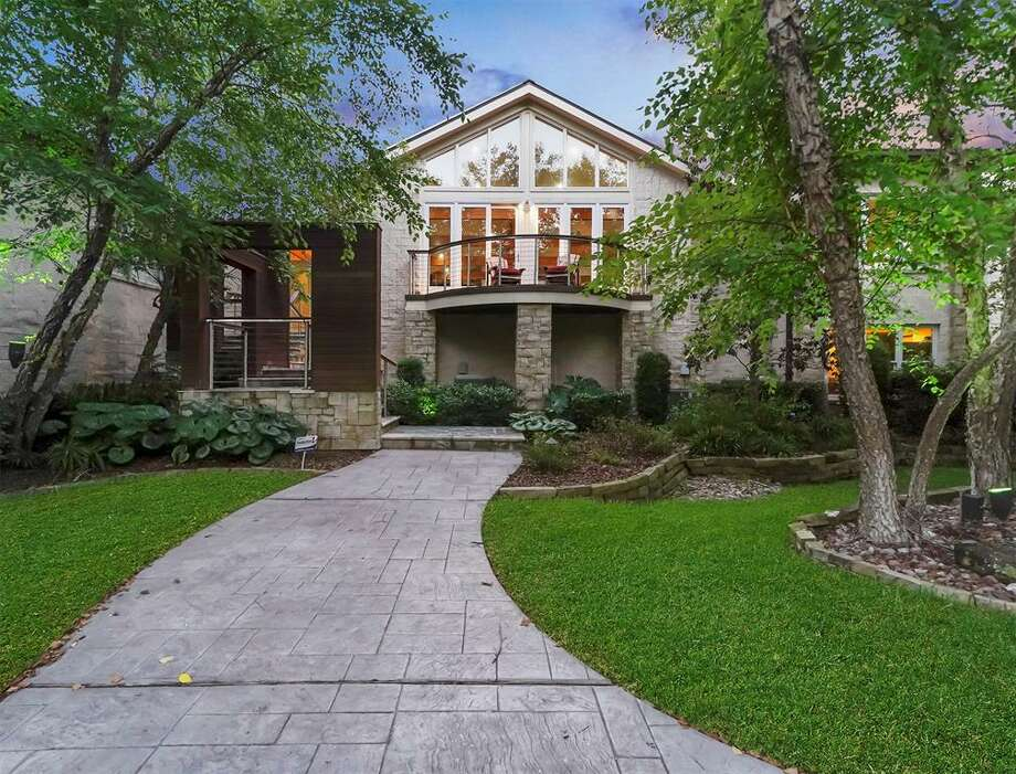 The home located at 405 West Spreading Oaks Avenue in Friendswood was designed and formerly owned by Houston attorney and mayoral candidate Tony Buzbee. Listed for $6.9 million, the sprawling, ten-acre estate offers seven bedrooms, five full and two half bathrooms, a massive resort-style pool with a 24-seat hot tub, personal sauna, wine cellar and cigar room, state-of-the-art chef's kitchen, gym, full tennis court, three separate garages and more. Photo: Premier Realty Services, James Evans