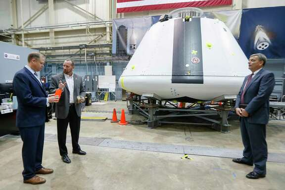 NASA Administrator Jim Bridenstine (left) toured the Orion Crew Module with Jon Olansen (center), Accent Abort-2 Crew Module Project Manager, and Mark Kirasich, Orion Program Manager on Aug. 2, 2018, in Houston.