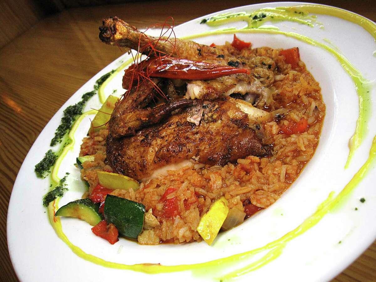 Arroz con pollo incorporates chicken, rice and vegetables at CoCo Bongo Cocina & Bar.