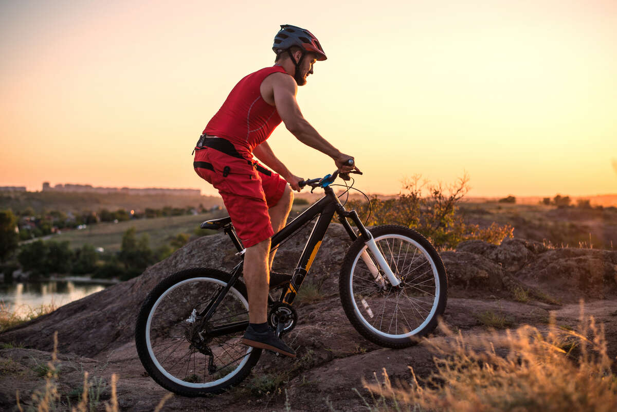 When cycling, wear a well-ventilated helmet, gloves and a pair of padded cycling shorts.