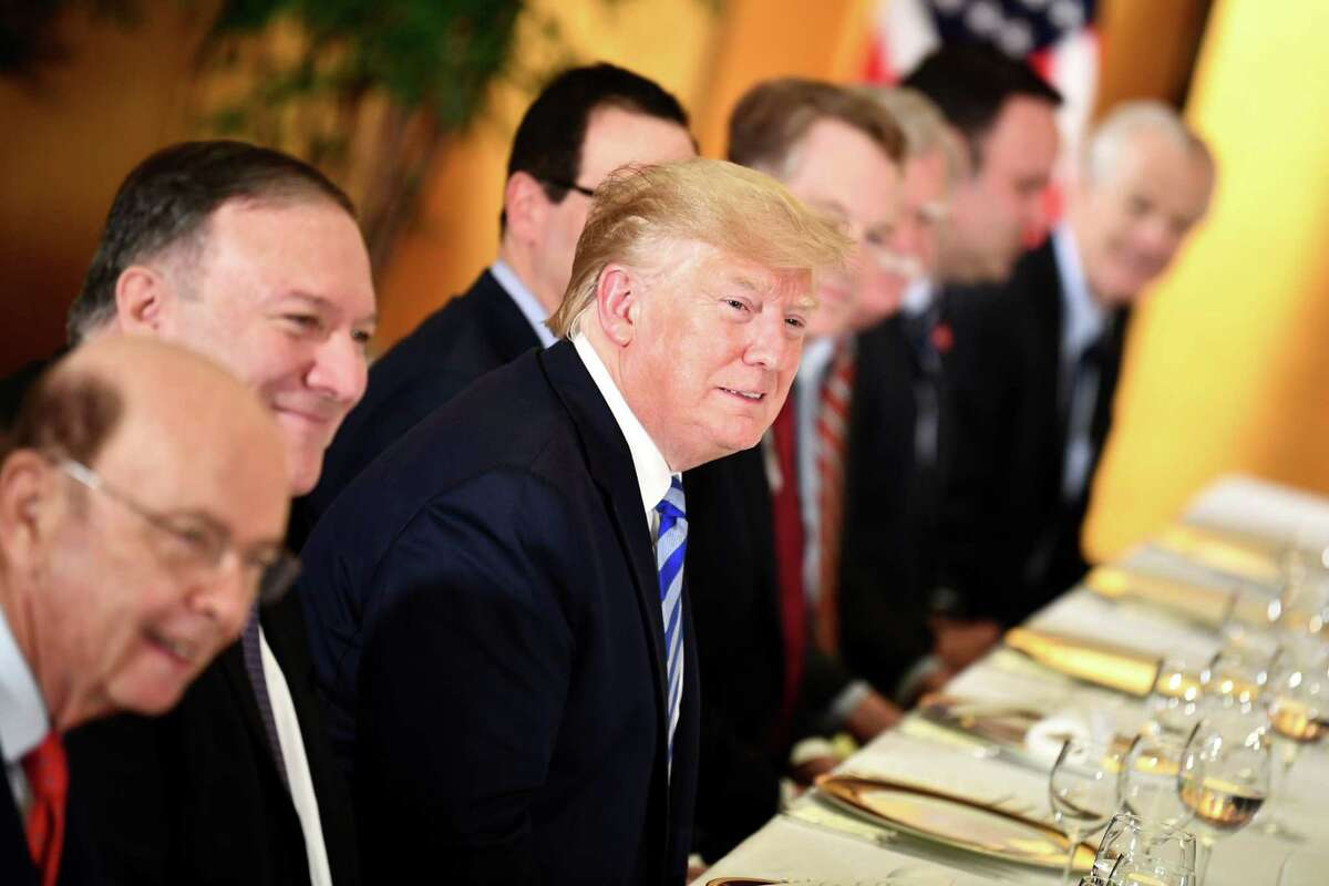 President Donald Trump attends a dinner with Australia's Prime Minister Scott Morrison in Osaka on June 27, 2019, ahead of the G20 Osaka Summit