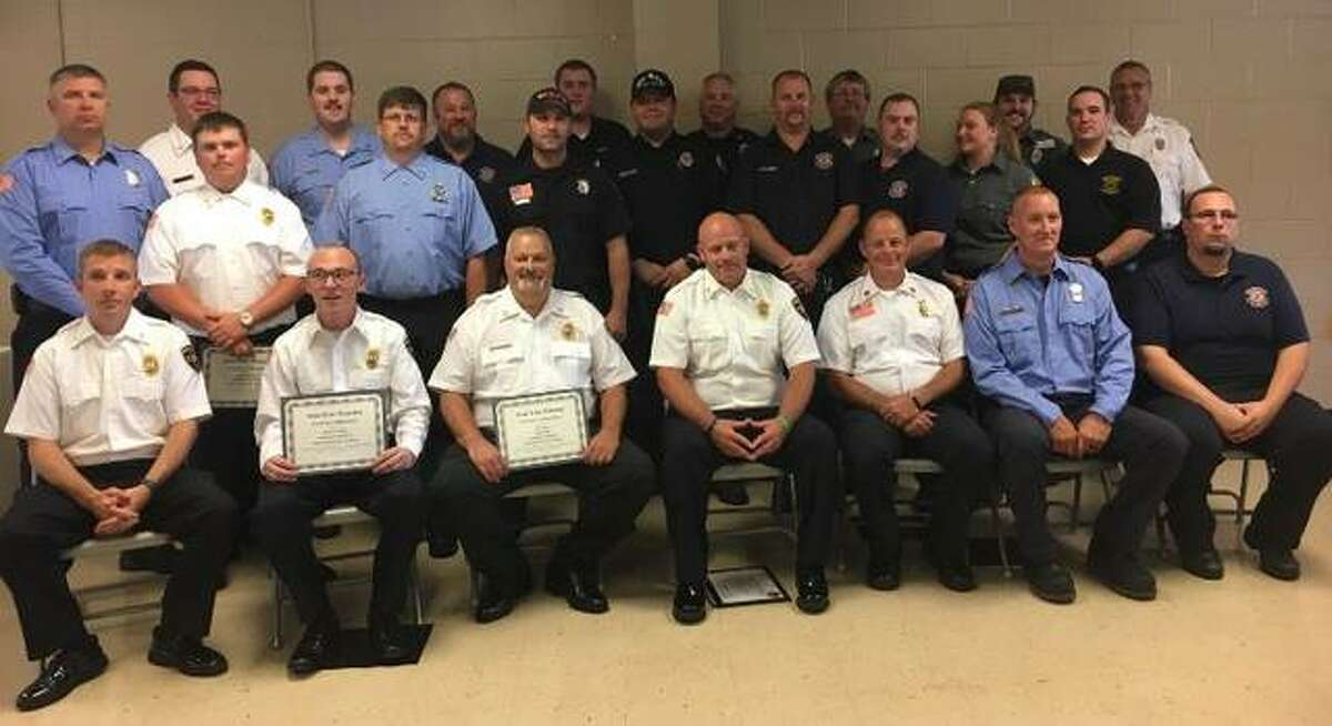 Rosewood Heights Fire Department Chief Tim Bunt on June 25 presented certificates to 27 first responders, many pictured here, for their efforts at a March 29 house fire in Rosewood Heights. Wood River Township also presented Bunt with a certificate for his work at the fire.