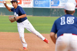 Plainview second baseman Zach Hernandez tosses over to first baseman Chance Winders for the out.