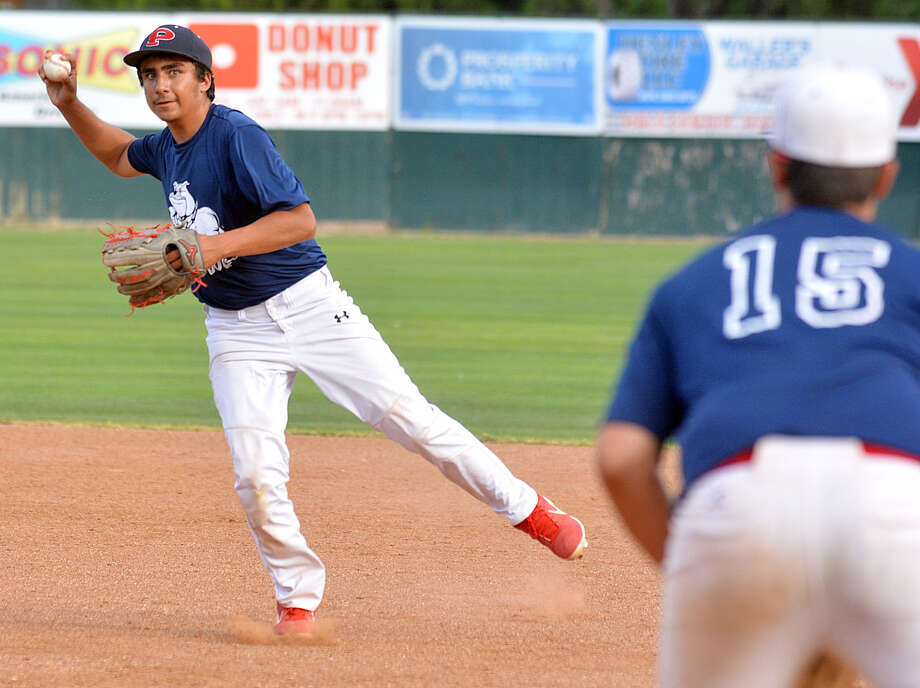 Plainview second baseman Zach Hernandez tosses over to first baseman Chance Winders for the out. Photo: Nathan Giese/Planview Herald