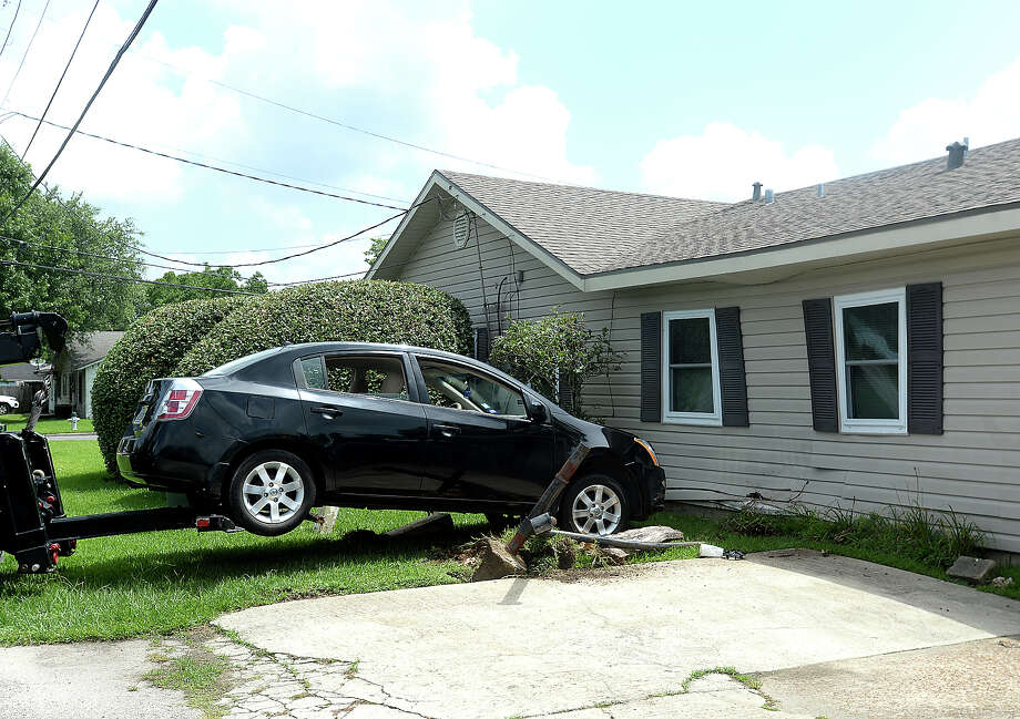 A vehicle driven by a man who appeared to be under the influence crashed into a home on Toledo Street in Beaumont Thursday.  Photo taken Thursday, June 27, 2019 Kim Brent/The Enterprise Photo: Kim Brent/The Enterprise