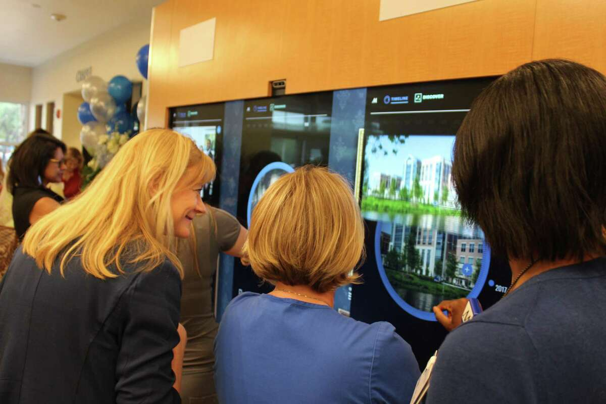 Staff members at Houston Methodist Clear Lake Hospital scanned 100 years of history of the Houston Methodist system via an 8-foot-tall interactive