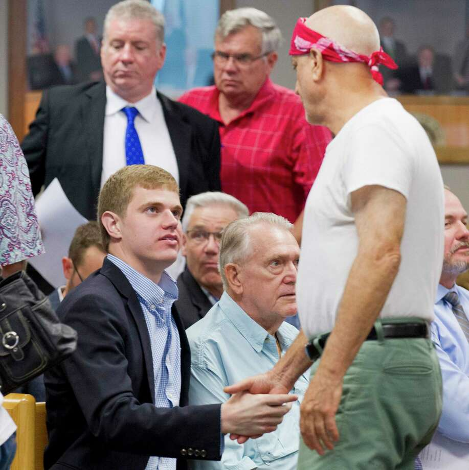 Reagan Reed, center, shakes hands with supports after members of the Montgomery County Commissioners Court voted 3-2 to removed him from the Montgomery County Ethics Committee during a meeting at the Alan B. Sadler Commissioners Court Building Tuesday. Photo: Jason Fochtman, Houston Chronicle / Staff Photographer / Houston Chronicle