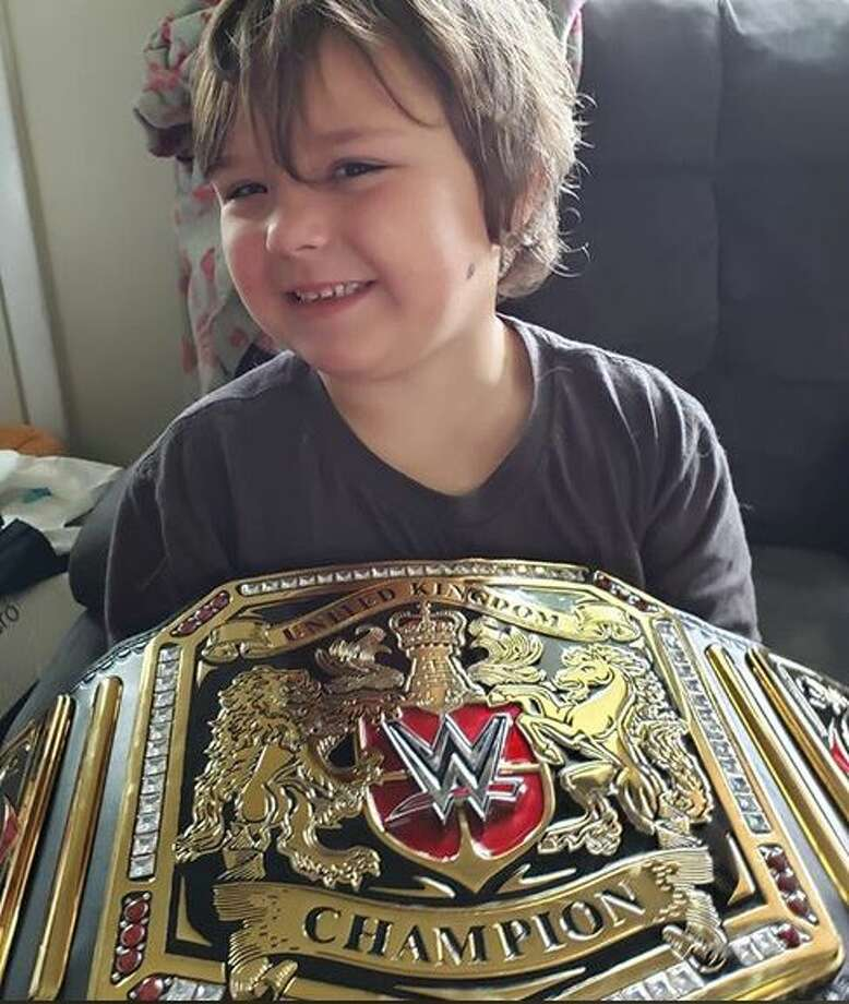Timmy shows off his one of a kind WWE belt. Photo: Pierce County Sheriff's Department